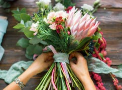A lovely bouquet is wrapped in ribbon for use in a Missouri wedding